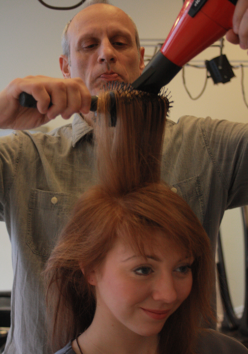 Hair stylist NYC-Lance Lappin cutting hair at downtown salon