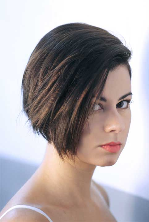 hairstylist regina betancourt wearing a bob hairstyle with a side part